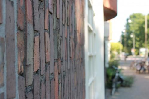 """Heute beinhaltet """"Het Schip"""" neben Wohnungen auch ein Museum, das sich mit der Architektur der Amsterdamer Schule beschäftigt.)"""
